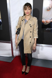 Amanda Peet donned black pointy pumps with skinny jeans and a trenchcoat for the New York screening of 'Enough Said.'