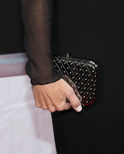 Julia Louis-Dreyfus accessorized her LBD with a fashionable textured silver hard-case clutch when she attended the New York screening of 'Enough Said.'