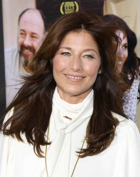 Catherine Keener left her hair loose with subtle feathered waves when she attended the New York screening of 'Enough Said.'