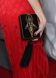 Tracey Fairaway carried an ultra-sophisticated gemstone-inlaid clutch to the New York screening of 'Enough Said.'