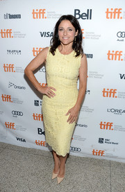 Julia Louis-Dreyfus went for classic sophistication in a pale yellow lace sheath during the premiere of 'Enough Said.'