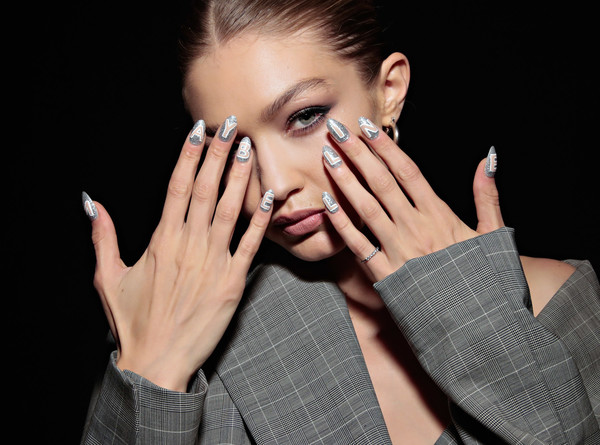 More Pics of Gigi Hadid Nail Art (1 of 1) - Gigi Hadid Lookbook - StyleBistro [entertainment best pictures of the day,face,skin,nail,finger,hand,eyebrow,beauty,nose,cheek,manicure,gigi hadid,us,new york city,maybelline new york international launch party]
