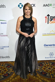 Katie Couric went rocker-glam in a black gown with a racer neckline, a snake-effect bodice, and an abstract-print skirt for the Stand Up to Cancer event.