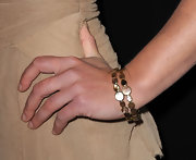 Julia Stiles attended the 63rd Annual DGA Awards and the Entertainment Weekly 2011 Pre-SAG party wearing 18-karat gold Rock Candy gelato bangles in brown shell.