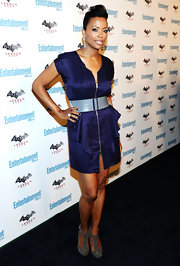 Aisha Tyler showed up at Comic-Con in a purple zip-front dress. The iridescent number was belted and worn with suede ankle booties.