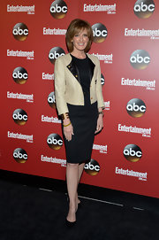 Ann Sweeney's black sheath dress was dressed up by a tan leather jacket.
