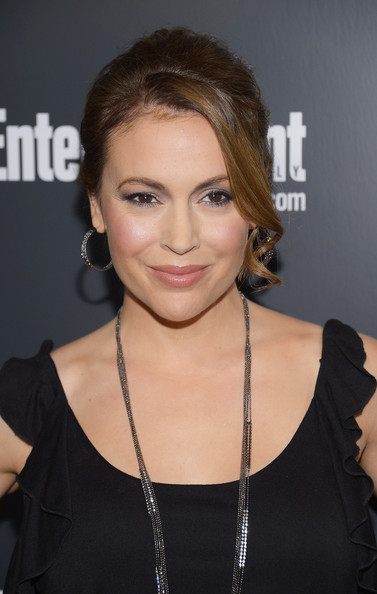 Alyssa Milano completed her look with a muted terra cotta lipstick.