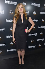 Connie Britton added a touch of color to her black and gray ensemble with a pop of bright pink nail polish.