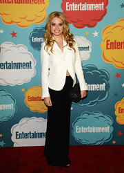 Emma Rigby stuck to simple black and white with a stark ivory blazer and a long flowing skirt.