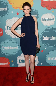Bitsie's draped midnight blue dress featured a high ruffle collar for a bit of an old English touch.
