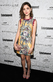 A marbled box clutch by Edie Parker finished off Natalia Dyer's ensemble.