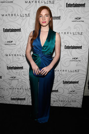 Annalise Basso complemented her outfit with a faceted satin clutch.