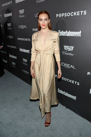Madeline Brewer styled her dress with red ankle-strap sandals by Chloe Gosselin.
