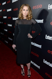 Anna Chlumsky chose a pair of black T-strap sandals to complete her red carpet outfit.