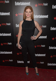 Embellished teal pumps added a welcome pop of color to Sarah Rafferty's black outfit.