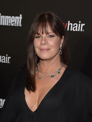 Marcia Gay Harden kept it simple with this long straight cut with bangs at the Entertainment Weekly SAG Awards nominee celebration.
