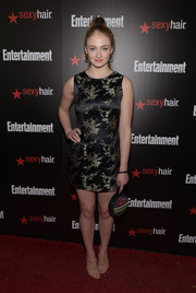 Sophie Turner showed some leg at the Entertainment Weekly SAG Awards nominee celebration in a black satin mini with Oriental-inspired gold floral embroidery.