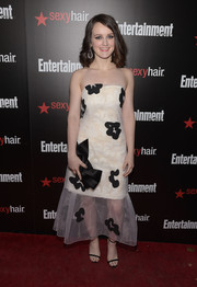 Sophie Mcshera donned a cute white Issa strapless dress with black floral accents for the Entertainment Weekly SAG Awards nominee celebration.