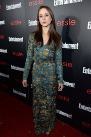Troian Bellisario was all glammed up in a gold-embroidered blue evening dress by Nicole Miller at the Entertainment Weekly SAG nominees celebration.