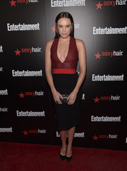 Jessica McNamee went for a busty look in a tight red and black dress with a deep-V plunge at the Entertainment Weekly SAG Awards nominee celebration.
