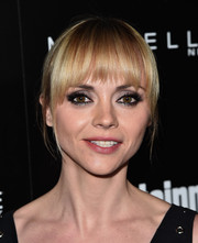 Christina Ricci wore her hair in a bun with wispy bangs during the Entertainment Weekly celebration honoring the SAG nominees.