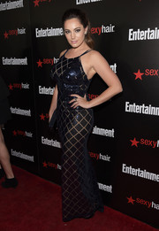 Kelly Brook showed off her voluptuous figure in a slinky black sequined gown at the Entertainment Weekly SAG Awards nominee celebration.