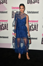 Jamie Chung teamed her cute frock with a multicolored beaded purse by Sensi Studio.
