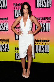 Chloe Bennet flashed some cleavage and thigh in a white high-slit halter dress at the Entertainment Weekly Comic-Con party.