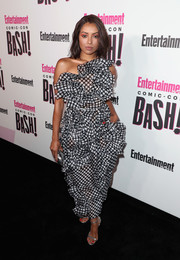 Kat Graham completed her look with silver ankle-strap sandals.