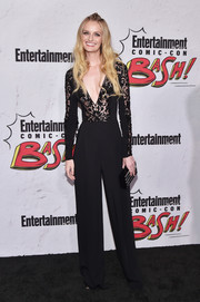 Lydia Hearst chose a black lace-bodice jumpsuit with a plunging neckline for the Entertainment Weekly Comic-Con party.