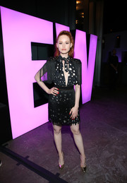 Madelaine Petsch looked party-ready in a black-and-white star-print dress with a fringed skirt and sleeves at the Entertainment Weekly Comic-Con party.