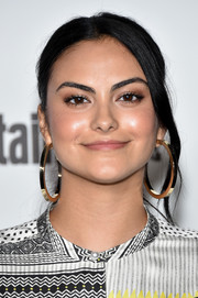 Camila Mendes glammed it up with a pair of oversized gold hoops.