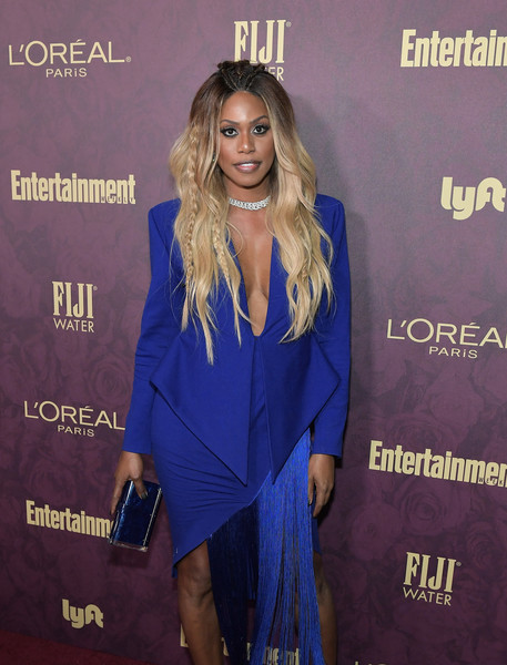 Laverne Cox matched a metallic blue clutch by Edie Parker with a fringed skirt suit for the Entertainment Weekly pre-Emmy party.
