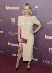 A burgundy satin envelope clutch rounded out Candace Cameron Bure's ensemble.