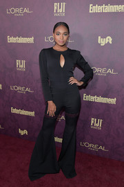 Chandler Kinney gave us '70s vibes with this black bell-bottom jumpsuit by Marcell von Berlin at the Entertainment Weekly pre-Emmy party.