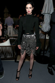 Krysten Ritter punched up her look with a silver cutout mini skirt by David Koma.