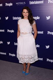 Katie Lowes complemented her top with a matching white skirt featuring an embellished waistband and a cutout hem.