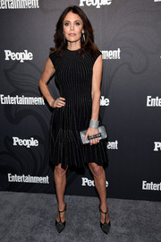 Bethenny Frankel rounded out her look with a black hand-strap clutch.