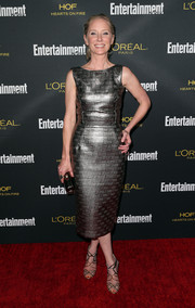 Anne Heche paired her dress with ultra-glam metallic strappy sandals.