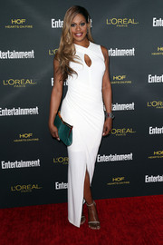 Laverne Cox completed her red carpet look with a pair of silver Stuart Weitzman sandals.