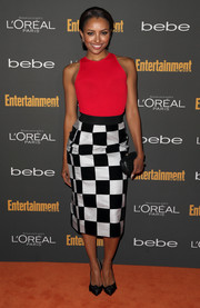 Kat Graham complemented her modern outfit with classic black satin pumps featuring knot detailing.