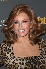 Raquel Welch topped off her head-turning look with a high-volume wavy 'do when she attended the Entertainment Weekly pre-Emmy party.
