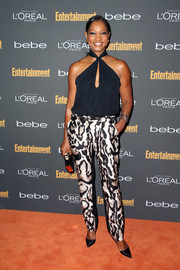 Garcelle Beauvais paired a navy halter top with animal-print pants for a sassy red carpet look during the Entertainment Weekly pre-Emmy party.