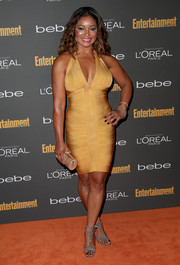 Tamala Jones looked very seductive in a gold bandage dress with a revealing neckline during the Entertainment Weekly pre-Emmy party.
