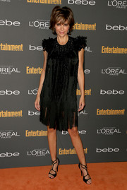 Lisa Rinna matched black strappy sandals with her LBD for a totally glam look.