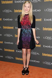 Peyton List attended the Entertainment Weekly pre-Emmy party wearing black platform sandals with a colorful print dress.