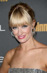 Beth Behrs wore a slightly messy updo with blunt bangs when she attended the Entertainment Weekly pre-Emmy party.