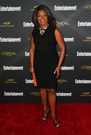 A pair of black strappy sandals added a dose of sexy glamour to Lorraine Toussaint's simple dress.