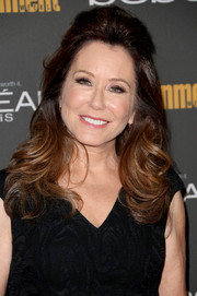 Mary McDonnell wore her hair in a half-up half-down style with a teased crown and wavy ends when she attended the Entertainment Weekly pre-Emmy party.