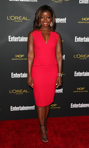 Erica Tazel brought a striking pop of color to the Entertainment Weekly pre-Emmy party with this sleeveless red BCBG Max Azria dress.
